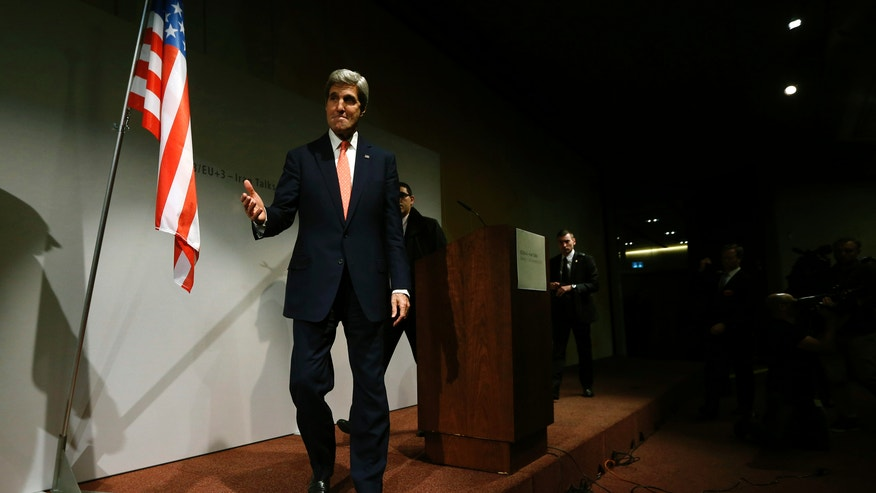 "U.S. Secretary of State John Kerry leaves after a news conference held at the end of the Iranian nuclear talks in Geneva, Sunday, Nov. 10, 2013. Nuclear talks with Iran have failed to reach agreement, but Kerry said differences between Tehran and six world powers made ""significant progress."" (AP Photo/Jason Reed, Pool)"