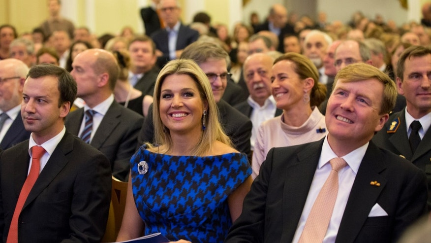 King Willem-Alexander of the Netherlands and Queen Maxima attend a concert by Royal Concertgebouw Orchestra at the Tchaikovsky Conservatorium in Moscow, Saturday, Nov. 9, 2013.  The royal visit was expected to showcase friendly ties between Russia and the Netherlands, but it comes amid increasing tensions over the seizure of the Dutch-flagged Greenpeace ship and its crew and other disputes. At left is Deputy Prime Minister Arkady Dvorkovich.  (AP Photo/Alexander Zemlianichenko, Pool)