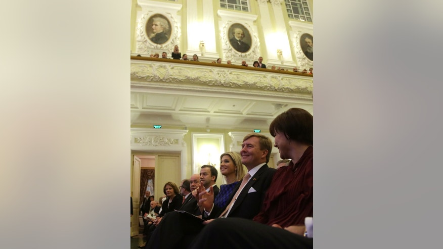 King Willem-Alexander of the Netherlands and Queen Maxima, third right, attend a concert by Royal Concertgebouw Orchestra at the Tchaikovsky Conservatory in Moscow, Saturday, Nov. 9, 2013.  The royal visit was expected to showcase friendly ties between Russia and the Netherlands, but it comes amid increasing tensions over the seizure of the Dutch-flagged Greenpeace ship and its crew and other disputes. (AP Photo/Maxim Shipenkov, Pool)