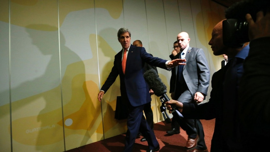 "U.S. Secretary of State John Kerry walks out of a press conference at the end of the Iranian nuclear talks in Geneva, Sunday, Nov. 10, 2013. Nuclear talks with Iran have failed to reach agreement, but Kerry said differences between Tehran and six world powers made ""significant progress."" (AP Photo/Jason Reed, Pool)"