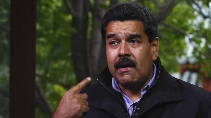 BEIJING, CHINA - SEPTEMBER 23:  (CHINA OUT) Venezuelan President Nicolas Maduro Moros is interviewed by Chinatoday, Chinadaily and CCTV at Diaoyutai State Guesthouse on September 23, 2013 in Beijing, China.  (Photo by ChinaFotoPress/Getty Images)