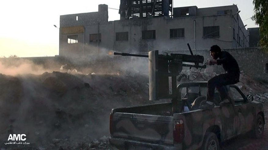 November 9, 2013: In this citizen journalism image, a Syrian rebel fires a weapon towards Syrian government troops loyal to President Bashar Assad in Aleppo, Syria. Activists said Syrian rebels have launched a counteroffensive in the northern city of Aleppo and recaptured a base near its international airport. (Aleppo Media Center)