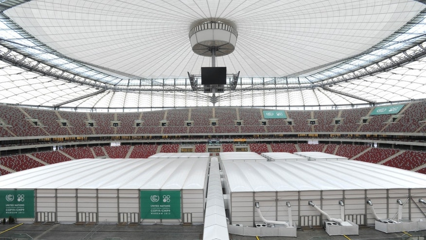 Special halls are set on the pitch of the National Stadium, the venue of the U.N. Climate Change Conference, in Warsaw, Poland, Sunday, Nov. 10, 2013. Climate envoys from rich countries, emerging economies and low-lying nations at risk of being swamped by rising seas will meet in Poland Monday for the next two weeks to lay the groundwork for a new global warming pact. (AP Photo/Alik Keplicz)