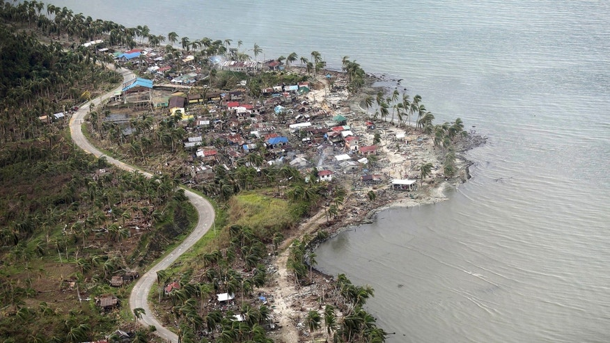 An aerial view shows the coast affected by Typhoon Haiyan  Thursday, Nov. 14, 2013 in Hernani, eastern Samar, central Philippines. Typhoon Haiyan, one of the strongest storms on record, slammed into 6 central Philippine islands on Friday leaving a wide swath of destruction and thousands of people displaced.(AP Photo/Wong Maye-E)
