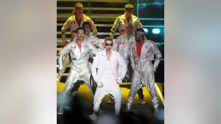 Canada's pop star Justin Bieber performs in concert during his Believe world tour in Buenos Aires, Argentina, Sunday, Nov. 10, 2013. Bieber's manager says food poisoning made him quit the stage during the concert,  drawing boos from a huge crowd in River Plate stadium. (AP Photo/Pablo Molina, DyN)