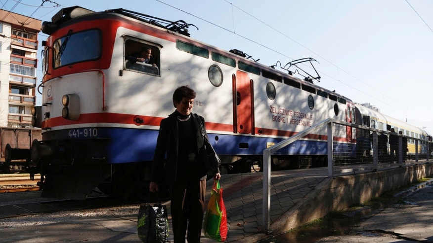 In this photo taken on Friday, Nov. 8. 2013 a Bosnian passenger exits a train in  Bosnian town of Zenica. They were seen as a shining example of Bosnia's rebirth from war: a fleet of high-speed trains built-to-order in the West. Eight years later, they haven't made a single ride. The reason: They're just too fast for Bosnia's 60-year-old rails.  (AP Photo/Amel Emric)