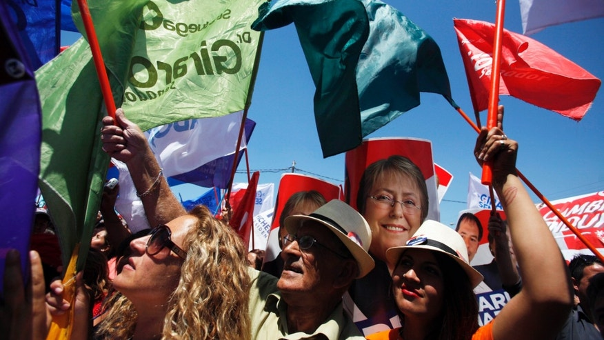 Supporters of Chile's former President Michelle Bachelet attend her campaign rally in Santiago, Chile, Tuesday, Nov. 12, 2013. Bachelet is running for reelection in Chile's general elections on Nov. 17. (AP Photo/Luis Hidalgo)