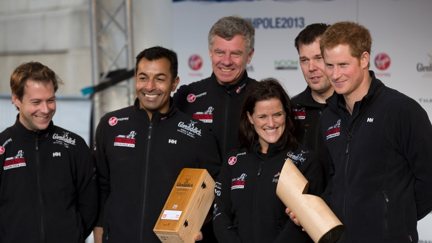"Britain's Prince Harry, right, poses for a group photograph on stage with his teammates, from left, single leg amputee Guy Disney, single leg amputee Ibrar Ali MC, team mentor Richard Eyre, single leg amputee Kate Philp and double leg amputee Duncan Slater during the ""Walking With The Wounded South Pole Allied Challenge"" departure event in Trafalgar Square, London, Thursday, Nov. 14, 2013. The Prince on Thursday joined other members of the three teams of wounded service men and women from the UK, U.S., and Commonwealth who he will race to the South Pole with on behalf of ""Walking With The Wounded"".  (AP Photo/Matt Dunham)"