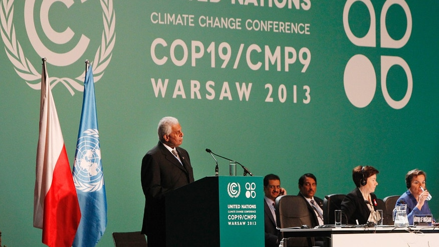 Qatar's Abdullah Bin Hamad Al-Attiyah,left,  President of  previous COP18 ( Conference of Parties)   addresses delegates during the opening session  of the United Nations  Climate Change Conference COP19   in Warsaw, Poland, Monday, Nov. 11, 2013. Thousands of participants from nations and environment organizations from around the world have opened two weeks of U.N. climate talks that are to lay the groundwork for a new pact to prevent global warming. (AP Photo/Czarek Sokolowski)