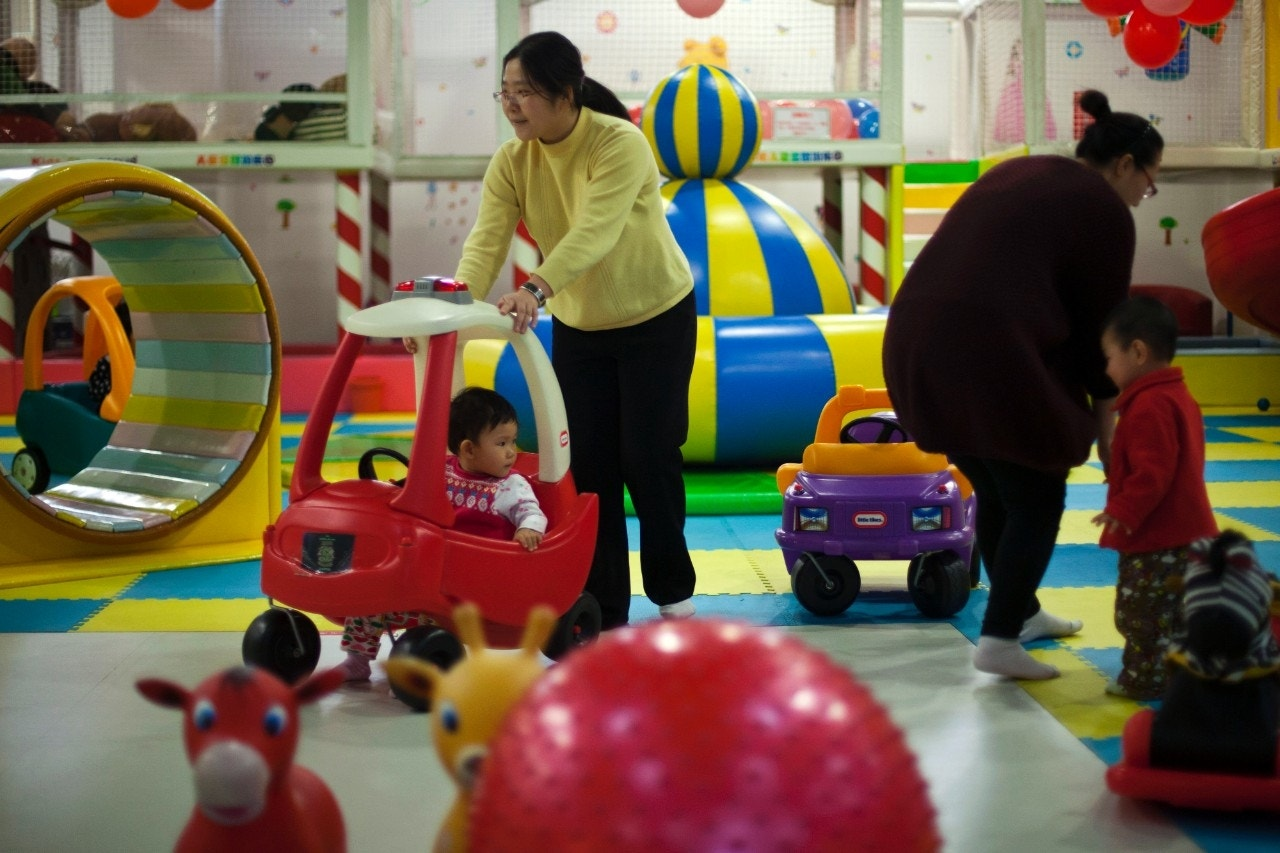 China to loosen 1 child policy, abolish labor camps