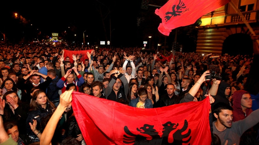 Thousands of Albanians in Tirana, Friday Nov. 15, 2013, greet the announcement by Prime Minister Edi Rama saying he turned down a request by the United States to be part of an operation to destroy Syria's chemical weapons stockpile, under the supervision of international experts. Albania, a NATO member, was seen as a possible choice since it recently destroyed its own poison gas arsenal. (AP Photo/Hektor Pusina)