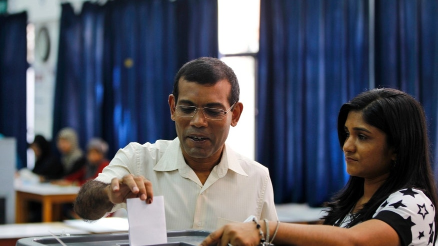 Former President Mohamed Nasheed casts his vote in Male, Maldives, Saturday, Nov. 16, 2013. Voters in the Maldives lined up Saturday in a presidential runoff that comes amid international concerns that the tiny archipelago nation may slip back to strongman rule after long delays in the election. (AP Photo/Sinan Hussain)