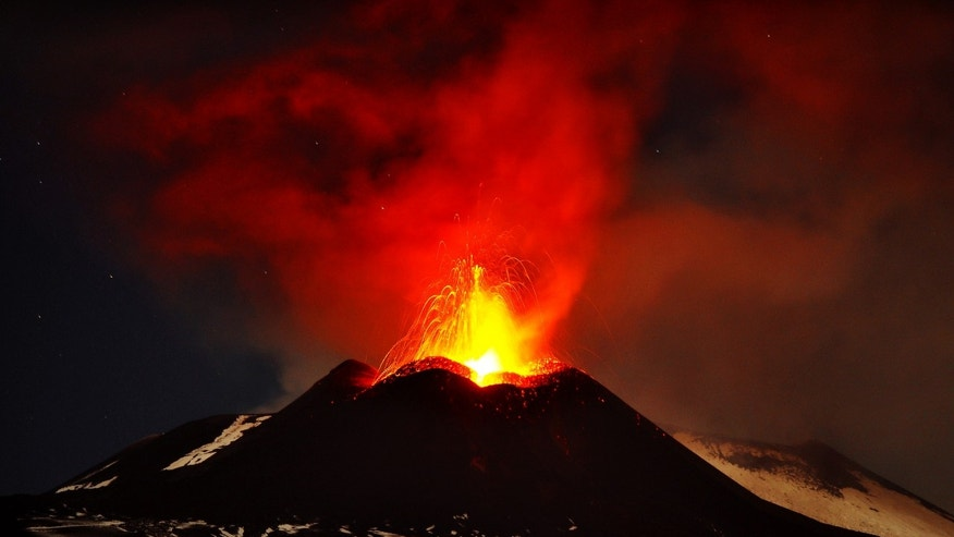 In this photo taken on Saturday, Nov. 16, 2013, Mt. Etna, Europe's most active volcano, spews lava during an eruption as seen from Acireale, near the Sicilian town of Catania, Italy. (AP Photo/Carmelo Imbesi)