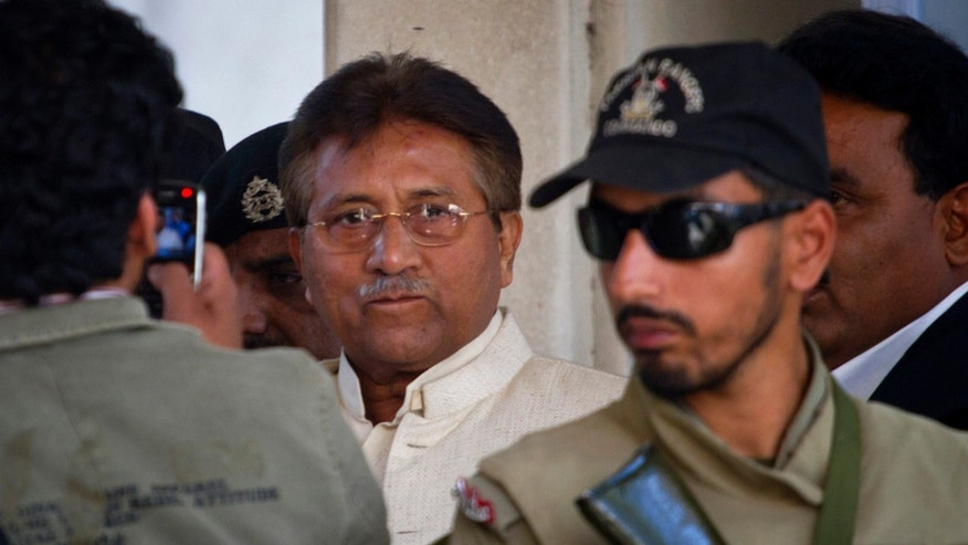 FILE -- In this Wednesday, April 17, 2013 file photo, Pakistan's former president and military ruler Pervez Musharraf, center, leaves after appearing in court in Rawalpindi, Pakistan. Pakistan's government plans to put former President Pervez Musharraf on trial for treason for declaring a state of emergency and suspending the constitution while in power, the interior minister said Sunday, Nov. 17, 2013. (AP Photo/Anjum Naveed, File)