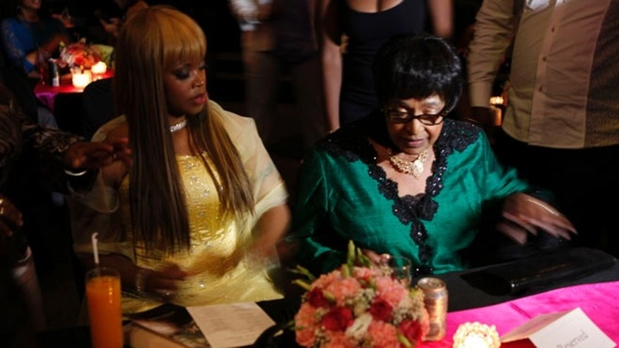 "Nov. 12, 2013: Author Zoleka Mandela, left, granddaughter of former president Nelson Mandela, and Winnie Madikizela-Mandela, right,  Nelson Mandela's former wife,  attends the launch of Zoleka's book ""When Hope Whispers,"" in Johannesburg."