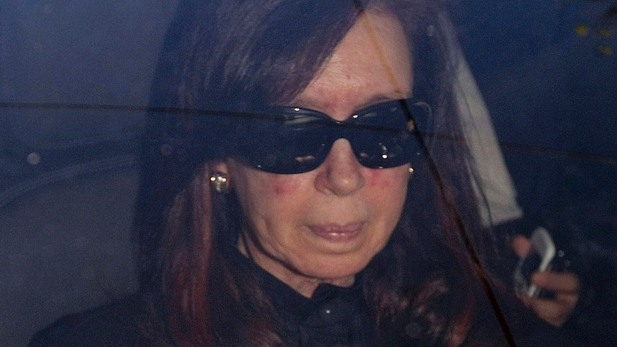 FILE - In this Oct. 7, 2013 file photo, Argentina's President Cristina Fernandez arrives to a local hospital for surgery, in Buenos Aires, Argentina.  On Monday, Nov. 18, Fernandez is officially returning to work after doctors removed a blood clot from her brain on Oct. 8. (AP Photo/DyN, Pablo Molina)