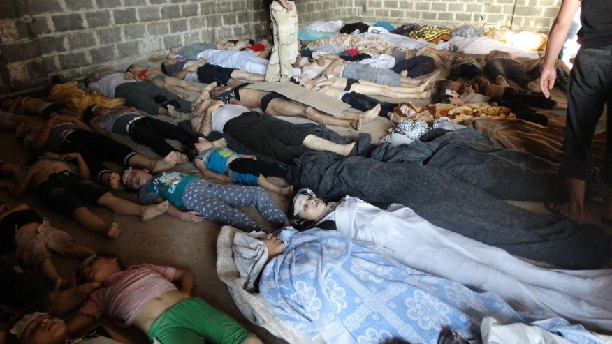 "File - This file image provided by Shaam News Network on Thursday, Aug. 22, 2013, which has been authenticated based on its contents and other AP reporting, purports to show dead bodies after an attack on Ghouta, Syria on Wednesday, Aug. 21, 2013. The tiny and impoverished Balkan nation of Albania was emerging Friday, Nov. 15, 2013 as a likely location for the destruction of Syria's chemical weapons stockpile. The Organization for the Prohibition of Chemical Weapons was discussing a plan to destroy its estimated 1,000-metric-ton arsenal, which includes mustard gas and the deadly nerve agent sarin. Syria says it wants the weapons destroyed outside the country and the OPCW has described that as the ""most viable"" option.(AP Photo/Shaam News Network, File)"