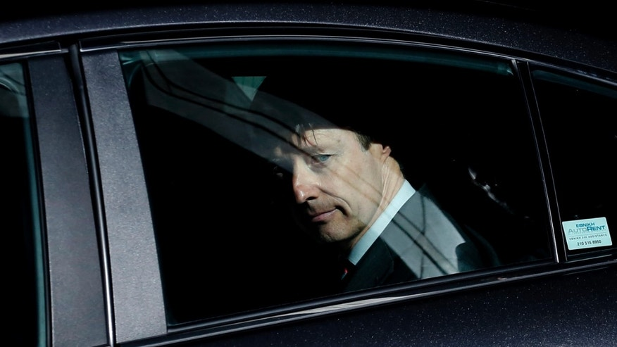 European Commission official Matthias Mors looks out from a car window as he leaves after a meeting with the Greek Finance Minister, in Athens on Monday Nov. 18 , 2013. The debt inspectors from the European Central Bank, European Commission and International Monetary Fund, known as the troika are in Athens to approve another bailout loan. (AP Photo/Petros Giannakouris)
