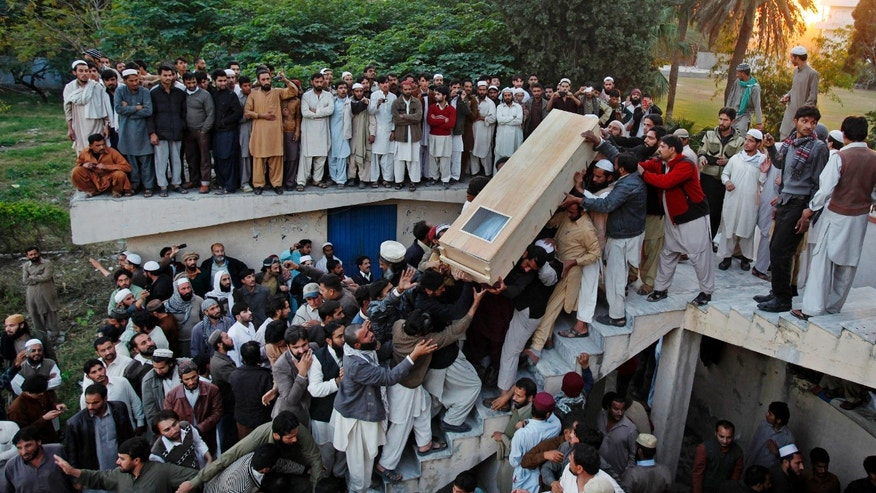 Pakistani Sunni Muslims carry the casket of a victim killed in Friday's sectarian clashes during funeral prayers in Rawalpindi, Pakistan, Sunday, Nov. 17, 2013. The Pakistani government imposed a rare curfew on Saturday in a northern city where sectarian clashes during a Shiite religious commemoration broke out the day before, while Taliban insurgents threatened to avenge the eight Sunni Muslims who authorities say were killed. (AP Photo/Anjum Naveed)