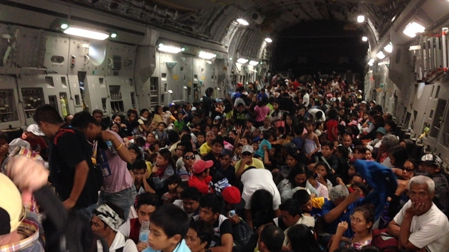Nov. 18, 2013 - The inside of a C-17 U.S. military plane which flew 683 people out of the Tacloban airport in the Philippines to the airport in Manila.  This was the largest number of people the US has airlifted out of the typhoon-devastated area of the Philippines yet. The plane was expected to travel to Okinawa, Japan next, to pick up more supplies-- water purification systems, trucks, wreckers, bulldozers.