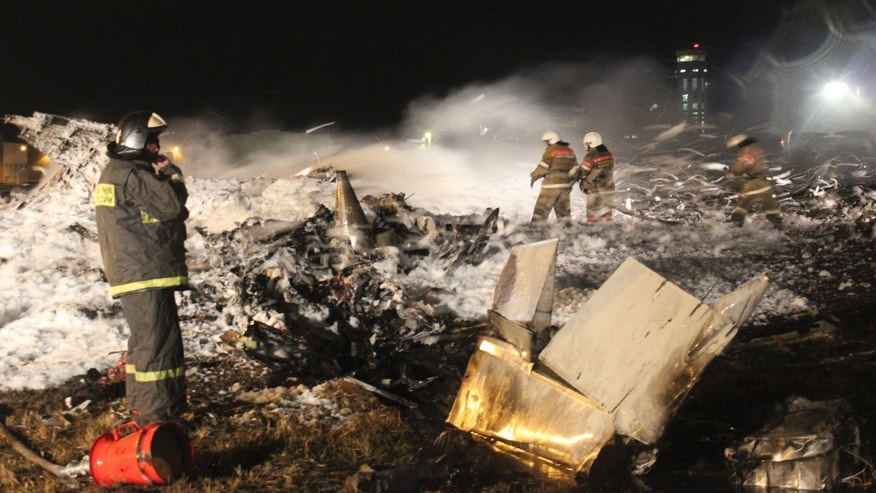 In this photo provided by Russian Emergency Situations Ministry fire fighters and rescuers work at the crash site of a Russian passenger airliner near Kazan, the capital of the Tatarstan republic, about 720 kilometers (450 miles) east of Moscow, Sunday, Nov. 17, 2013. A Russian passenger airliner crashed Sunday night while trying to land at the airport in the city of Kazan, killing all people aboard, officials said. The Boeing 737 belonging to Tatarstan Airlines crashed an hour after taking off from Moscow. There were no immediate indications of the cause. (AP Photo/Russian Emergency Situations Ministry)