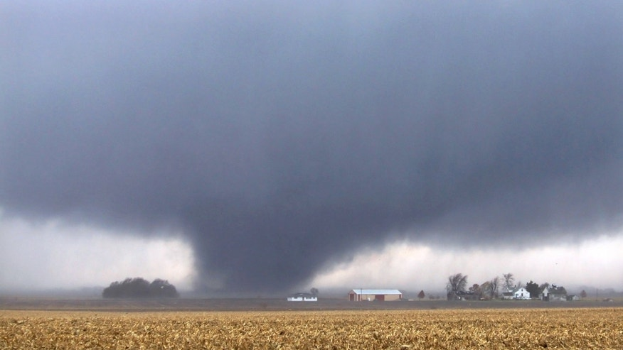 A tornado moves northeast Sunday, Nov. 17, 2013, two miles west of Flatville, Ill. The tornado damaged many farm buildings and homes on its way to Gifford, Ill., where scores of houses were devastated.  (AP Photo/News-Gazette, Jessie Starkey) MANDATORY CREDIT