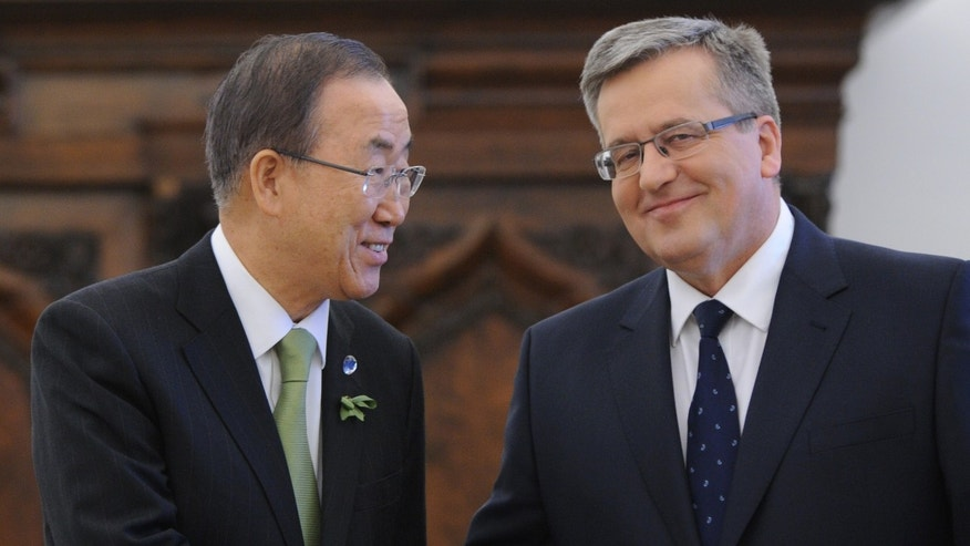 United Nations Secretary General Ban Ki-moon, left, and Polish President Bronislaw Komorowski shake hands  prior to their meeting , in Warsaw, Poland, Tuesday, Nov. 19, 2013. Ban Ki-moon will attend the U.N. Climate Conference held in Warsaw.  (AP Photo/Alik Keplicz)
