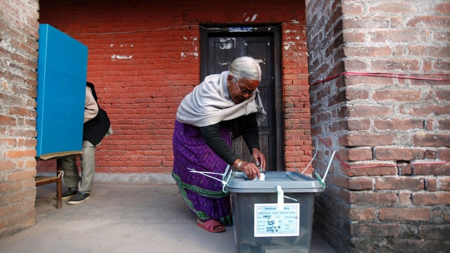 An elderly Nepalese woman casts her vote at a polling station in Bhaktapur, Nepal, Tuesday, Nov. 19, 2013. Voters casts their ballots across Nepal on Tuesday to elect a Constituent Assembly that will attempt again to write a constitution that could bring stability to the Himalayan nation.   (AP Photo/Niranjan Shrestha)