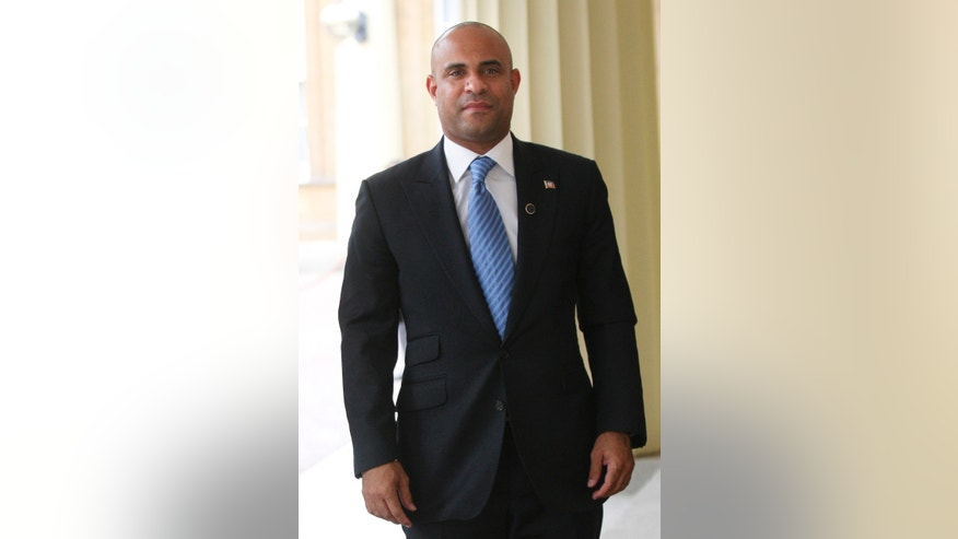 FILE - Laurent Lamothe, Haitian Prime Minister and Minister of Foreign Affairs, arrives at Buckingham Palace in London in this July 27, 2012 file photo. Lamothe plans to spend Wednesday Nov. 20, 2013 on a whirlwind tour through Silicon Valley's most elite tech campuses, hoping to convince some of the world's wealthiest and most successful corporate executives to share support and innovation with the poorest country in the Americas. (AP Photo/CARL COURT, File)