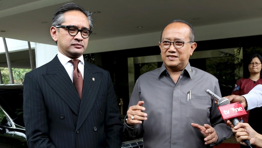 Indonesian Ambassador to Australia Nadjib Riphat Kesoema, right, speaks to journalists next to Indonesian Foreign Minister Marty Natalegawa after their meeting in Jakarta, Indonesia, Wednesday, Nov. 20, 2013. Indonesia recalled the ambassador from Australia following reports that Australian spies attempted to listen in on phone conversations of Indonesian President Susilo Bambang Yudhoyono and other senior figures. Yudhoyono on Tuesday criticized Australian Prime Minister Tony Abbott for not expressing remorse over the alleged wiretapping of his phone, and said cooperation agreements between the near-neighbors would be reviewed. (AP Photo/Tatan Syuflana)