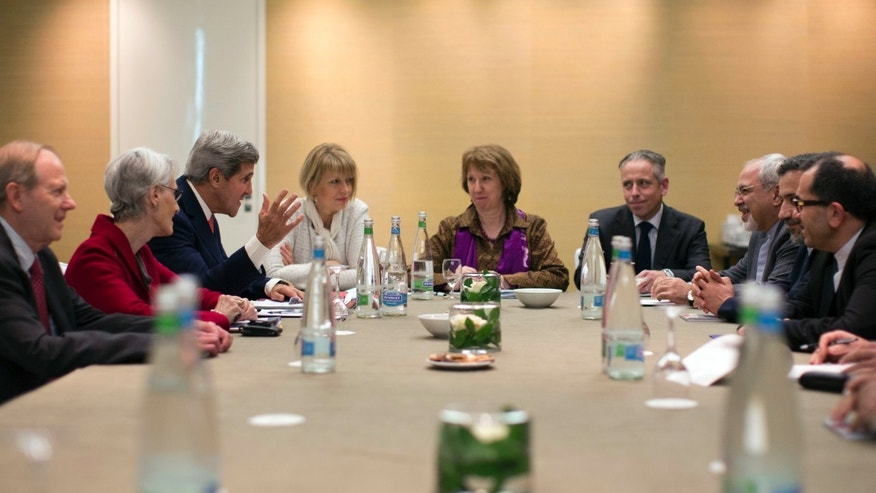 FILE -In this Nov. 9, 2013,  file photo, U.S. Secretary of State John Kerry, third left, meets with EU High Representative for Foreign Affairs, Catherine Ashton, center, and Iranian Foreign Minister Mohammad Javad Zarif, third right,  at the Iran Nuclear talks in Geneva, Switzerland.  Since the start of talks on Iran's nuclear program, Iran has asserted it has a right to enrich uranium — and the United States has disagreed. Both have refused to budge over nearly a decade of negotiations. Until now. Iran has suddenly gone public with a significant concession just days ahead of a new round of talks  starting Wednesday Nov. 20, 2013 with six world powers in Geneva. It still insists that it has a right to the program, but it now says that the six no longer need to publicly acknowledge its claim, opening a way to sidestep the dispute and focus on more practical steps both sides can agree on.  The talks begin with a series of meetings Wednesday evening and are scheduled to go into Friday.( AP Photo/Jason Reed, Pool, File)