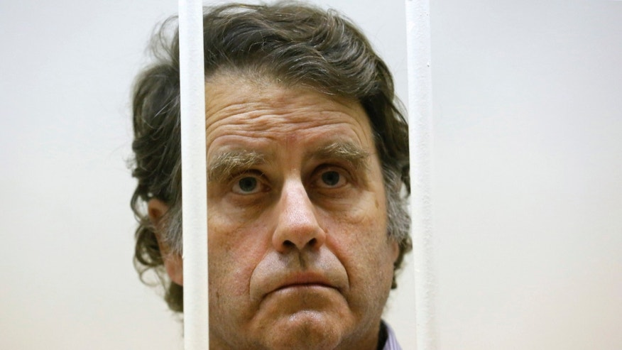 Greenpeace International activist and captain of the Greenpeace ship Arctic Sunrise Peter Willcox of the U.S. listens from inside a barred enclosure at a courtroom during a hearing that is considering investigators' request to extend the detention of 30 members of the Arctic Sunrise in St. Petersburg, Russia, Wednesday, Nov. 20, 2013. A Russian court on Tuesday granted bail to Greenpeace protesters from Argentina, Brazil, New Zealand, Canada, Poland and Finland, the first foreign activists eligible to be released from jail while awaiting trial for participating in a demonstration outside a Russian oil rig.  (AP Photo/Dmitry Lovetsky)