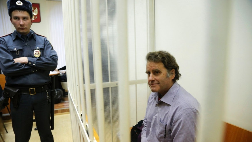 Greenpeace International activist and captain of the Greenpeace ship Arctic Sunrise Peter Willcox of the U.S. sits inside a barred enclosure at a courtroom during a hearing that is considering investigators' request to extend the detention of 30 members of the Arctic Sunrise in St. Petersburg, Russia, Wednesday, Nov. 20, 2013. A Russian court on Tuesday granted bail to Greenpeace protesters from Argentina, Brazil, New Zealand, Canada, Poland and Finland, the first foreign activists eligible to be released from jail while awaiting trial for participating in a demonstration outside a Russian oil rig.  (AP Photo/Dmitry Lovetsky)