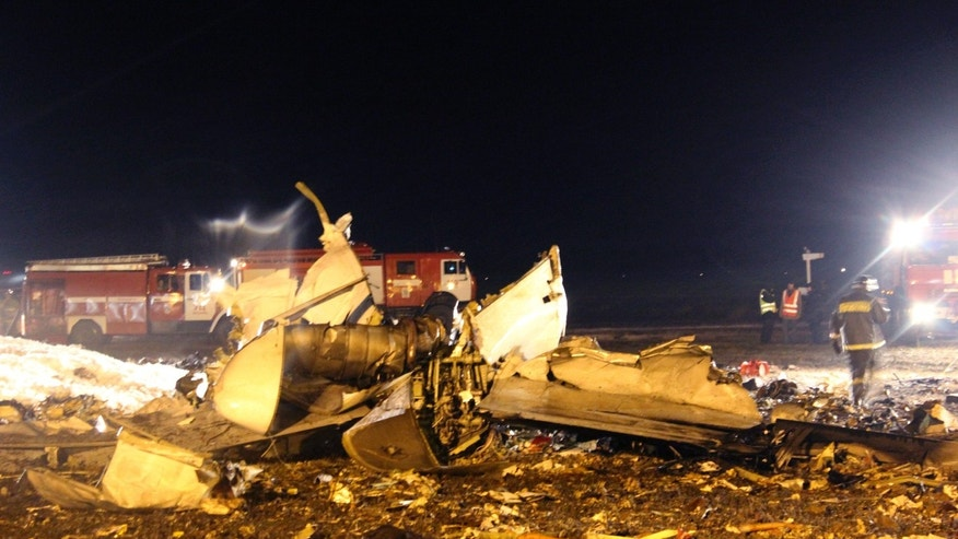 In this photo provided by Russian Emergency Situations Ministry, firefighters and rescuers work at the crash site of a Russian passenger airliner near Kazan, the capital of the Tatarstan republic, about 720 kilometers (450 miles) east of Moscow, on Sunday, Nov. 17, 2013. The Russian passenger airliner crashed Sunday night while trying to land at the airport in the city of Kazan, killing all 50 people onboard, officials said. The Boeing 737 belonging to Tatarstan Airlines crashed an hour after taking off from Moscow. There were no immediate indications of the cause. (AP Photo/Russian Emergency Situations Ministry)