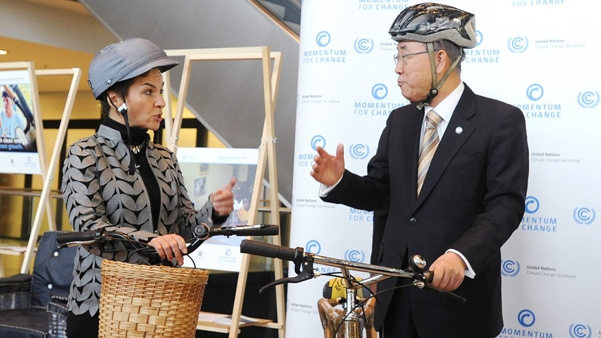 United Nations Secretary General Ban Ki-moon, right, and Executive Secretary of the UN Framework Convention on Climate Change Christiana Figueres, left, talk  during a meeting with the Ghana Bamboo Bike initiative, at the UN Climate Conference in Warsaw, Poland, Wednesday, Nov. 20, 2013. (AP Photo/Alik Keplicz)