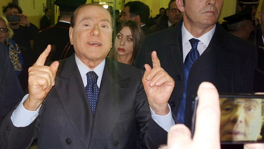 March 1, 2013: Former Italian Premier Silvio Berlusconi speaks to reporters after a hearing in his Mediaset appeals trial, at Milan's court, Italy.
