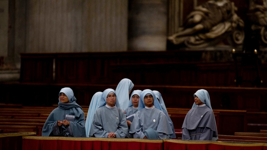 Nuns wait for the arrival of Pope Francis for a ceremony to bless a mosaic dedicated to Filipino St. Pedro Calungsod, in St. Peter's Basilica at the Vatican, Thursday, Nov. 21, 2013. (AP Photo/Andrew Medichini)