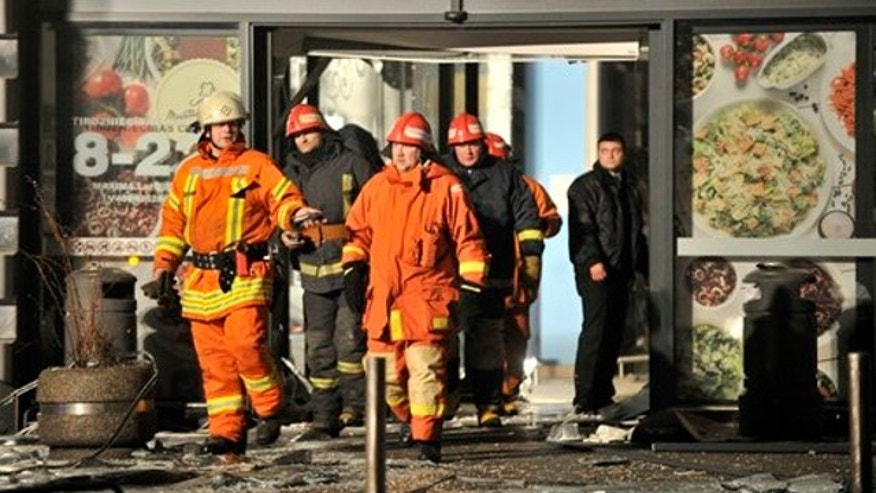 Nov. 21, 2013: Rescuers work at the Maxima grocery store after its roof collapsed in Riga, Latvia.