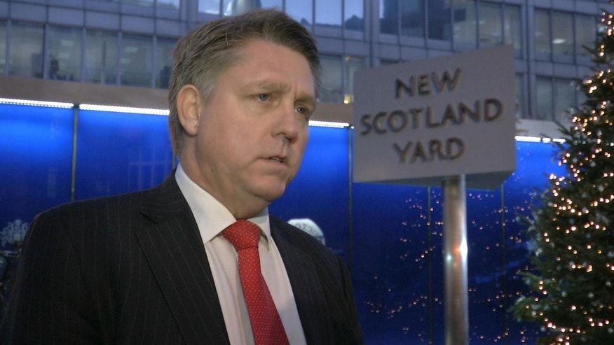 Kevin Hyland, head of the Metropolitan Police's human trafficking unit speaks to the media outside New Scotland Yard's  London headquarters in this image taken from TV Thursday Nov. 21, 2013. London police say three women were held for at least 30 years against their will in a south London home. Metropolitan Police revealed Thursday the women had been rescued and announced the arrests of two people as part of an investigation into slavery and domestic servitude. (AP Photo/ Sky TV, via Associated Press Television) UNITED KINGDOM OUT TV OUT