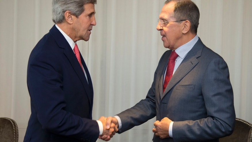 Nov. 23, 2013: U.S. Secretary of State John Kerry (L) and Russia's Foreign Minister Sergei Lavrov shake hands during a photo opportunity prior to their meeting, in Geneva.