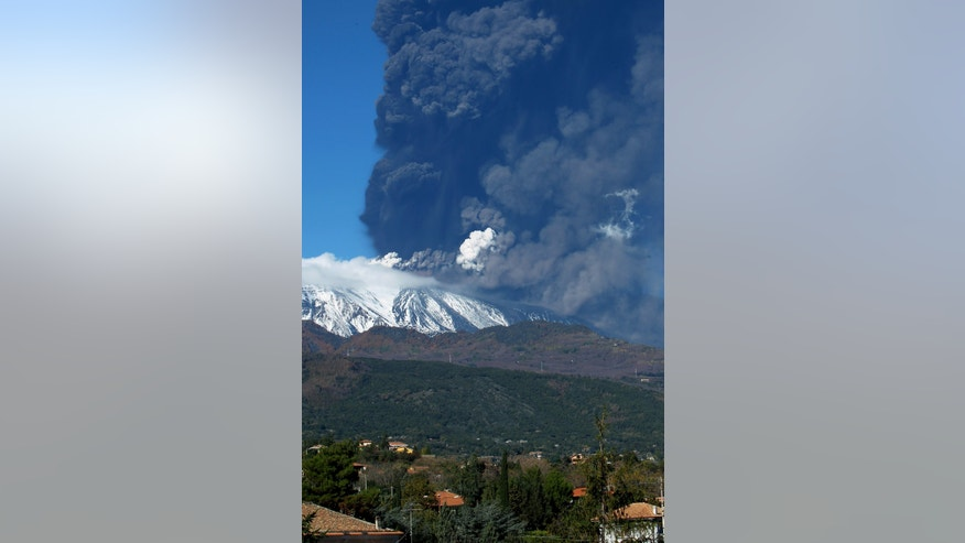 Smoke billows from the Mount Etna, Europe's tallest active volcano, Sicily, Saturday, Nov. 23, 2013. (AP Photo/Carmelo Imbesi)