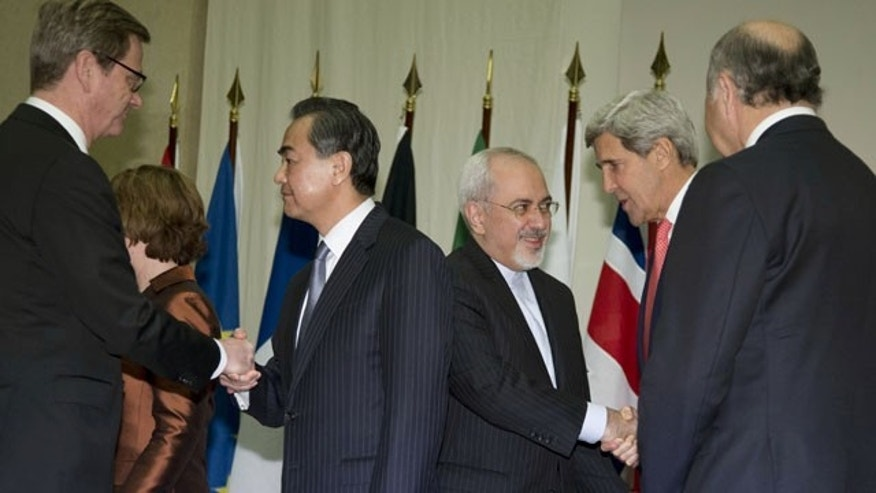 November 24, 2013: From left, Germany's Foreign Minister Guido Westerwelle, Chinese Foreign Minister Wang Yi, Iranian Foreign Minister Mohammad Javad Zarif, U.S. Secretary of State John Kerry, and French Foreign Minister Laurent Fabius greet each other and shake hands at the United Nations Palais in Geneva, Switzerland, at the Iran nuclear talks. (AP Photo)
