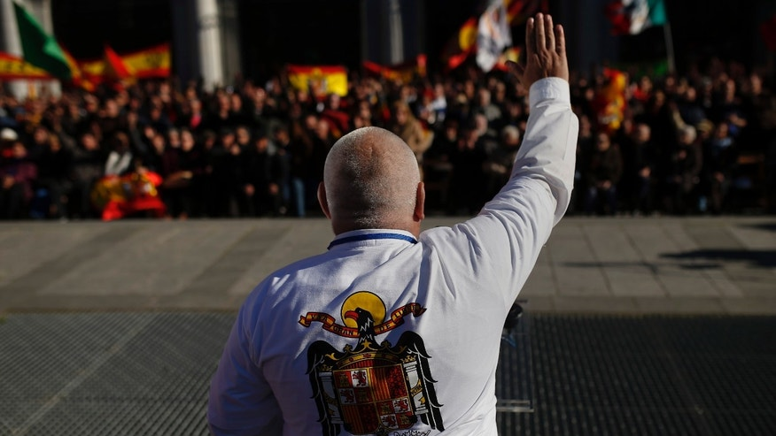 A fascist leader makes a fascist salute to the crowd during his speech as they remember the former Spanish Dictator Gen. Francisco Franco on the 38th anniversary of his death, in Madrid, Spain, Sunday, Nov. 24, 2013. Hundreds of people nostalgic for Spain's fascist past held a rally on Sunday to mark the 38th anniversary of dictator Francisco Franco's death. The peaceful demonstration was held in Madrid's central Plaza de Oriente square near the opera and Royal Palace in the city's old quarter. On Saturday an anti-Franco protest was held northwest of Madrid at Franco's mausoleum. (AP Photo/Andres Kudacki)