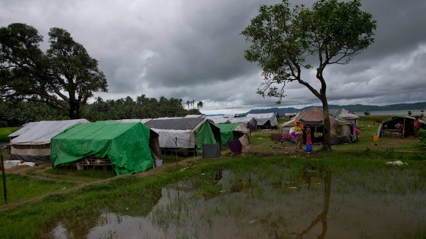 In this Sept. 17, 2013 photo, Muslims who were displaced following 2012 sectarian violence take shelter at a camp for the internally displaced in Pauktaw, northern Rakhine state, Myanmar. Sectarian violence has gripped this predominantly Buddhist nation of 60 million for more than a year, killing more than 240 people and forcing another 250,000 from their homes. The vast majority of victims have been Rohingya and other Muslims, but Rohingya also have been the main targets of the government crackdown that followed. (AP Photo/Gemunu Amarasinghe)