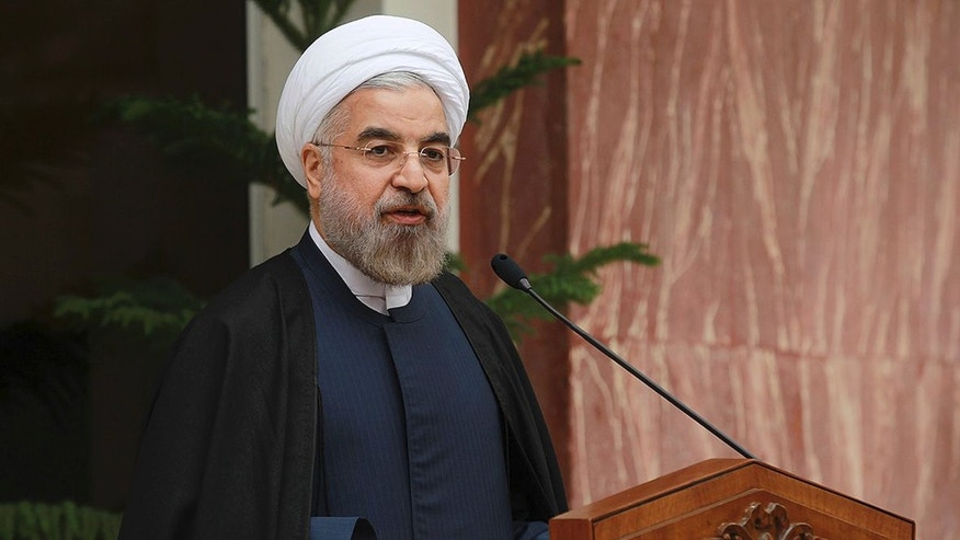 In this photo released by the official website of the office of the Iranian Presidency, Iran's President Hassan Rouhani speaks during a news briefing after Iran and world powers agree in Geneva to a deal over Iran's nuclear program, at the Presidency compound in Tehran, Iran, Sunday, Nov. 24, 2013. Iran struck a deal with the U.S. and five other world powers, agreeing to a temporary freeze of its nuclear program in the most significant agreement between Washington and Tehran in more than three decades. The deal commits Iran to curb its nuclear activities for six months in exchange for limited sanctions relief. (AP Photo/Presidency Office, Mohammad Berno)