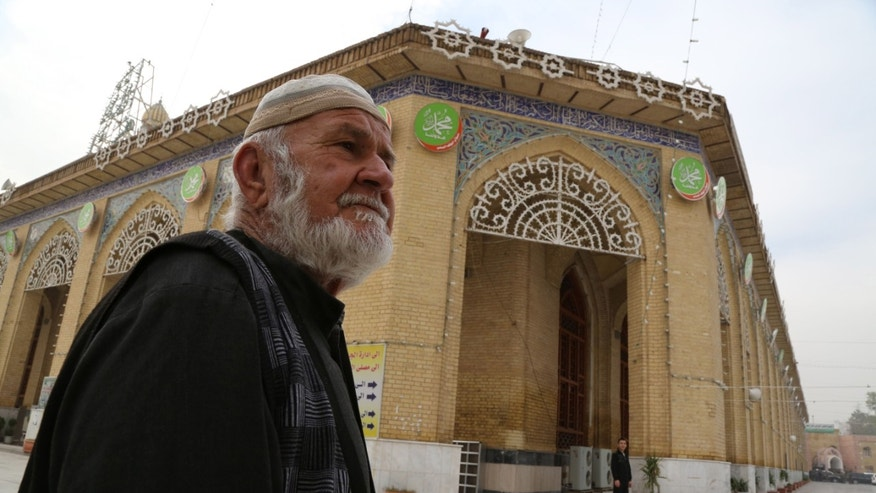 A Sunni worshiper leaves the Sunni Abu Hanifa mosque after he finds out it is closed at Azamiya area in north Baghdad, Iraq, Saturday, Nov. 23, 2013. Sunni religious leaders said on Saturday that they have decided to close down the sect's mosques in Baghdad indefinitely to protest attacks targeting clerics and worshippers, highlighting Iraq's deepening sectarian rift. (AP Photo/Karim Kadim)