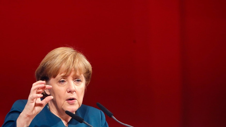 German Chancellor Angela Merkel speaks during a union rally of German metalworkers union in Frankfurt, Germany, Monday, Nov. 25, 2013. (AP Photo/Michael Probst)