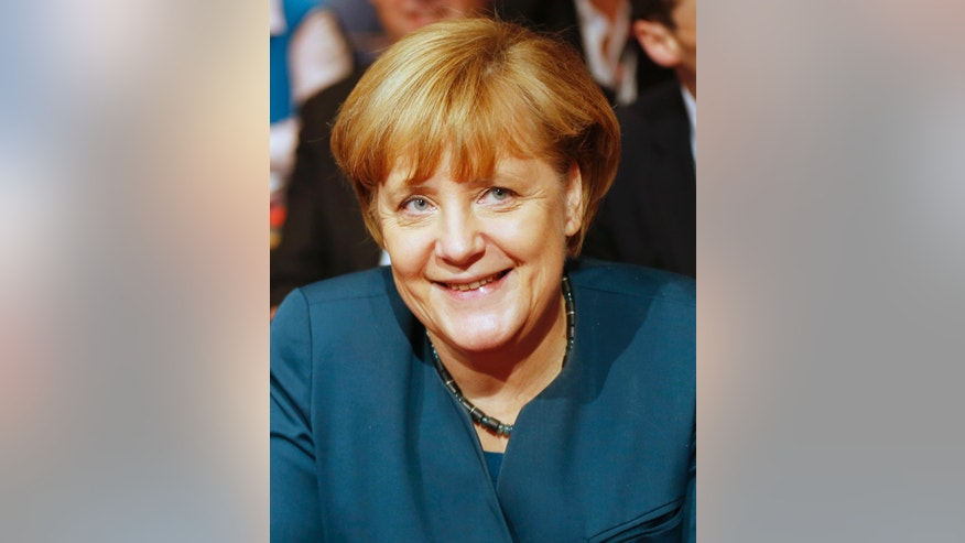 German Chancellor Angela Merkel smiles as she attends a union rally of German metalworkers union in Frankfurt, Germany, Monday, Nov. 25, 2013. (AP Photo/Michael Probst)
