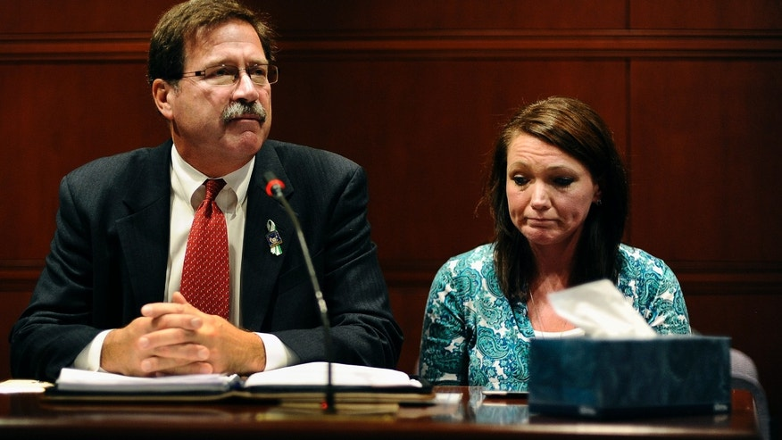 Bill Sherlach, husband of Sandy Hook Elementary School shooting victim Mary Sherlach, and Nicole Hockley, mother of victim Dylan Hockley, speak before the Task Force on Victim Privacy and the Publics Right To Know, Wednesday, Oct. 30, 2013, in Hartford, Conn. They told the panel they don't want the 911 tapes from that day released to the public.