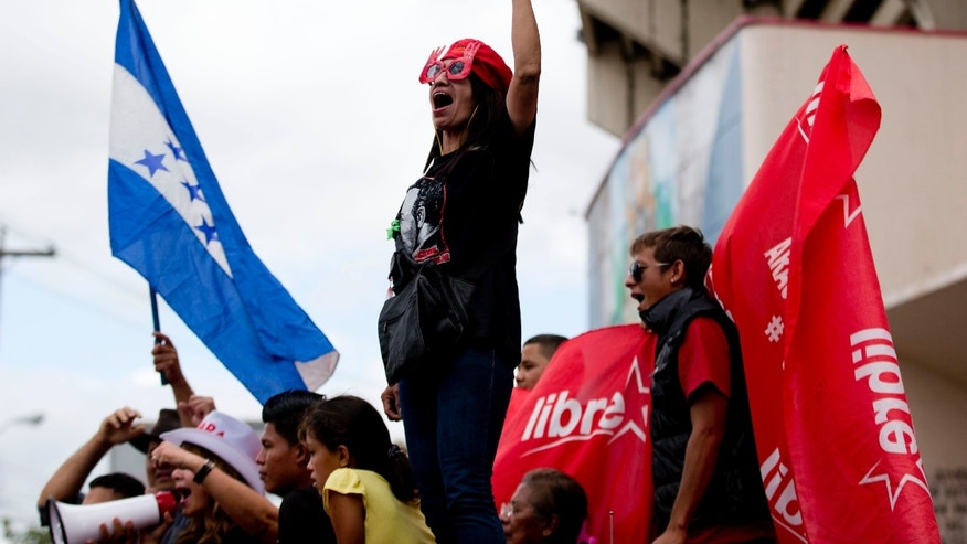 A supporter of Free Party presidential candidate Xiomara Castro shouts slogans during a protest against election results in Tegucigalpa, Honduras, Monday, Nov. 25, 2013. The two top presidential candidates continued to claim victory Monday in a hotly contested presidential race, as Hondurans awaited final results. (AP Photo/Eduardo Verdugo)